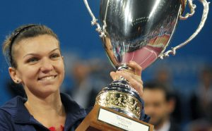 Romania's Simona Halep celebrates with the cup after winning the WTA tennis Tournament of Champions final match against Australia's Samantha Stosur in Sofia on November 3, 2013. AFP PHOTO / NIKOLAY DOYCHINOV        (Photo credit should read NIKOLAY DOYCHINOV/AFP/Getty Images)